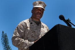 Sgt. Maj. James R. Futrell, U.S. Marine Corps Forces, Pacific sergeant major, delivers a farewell speech during the relief, appointment and retirement ceremony at Dewey Square here July 19. Futrell retired after 33 years of service, while Sgt. Maj. William T. Stables stepped in to carry on as the new force sergeant major.