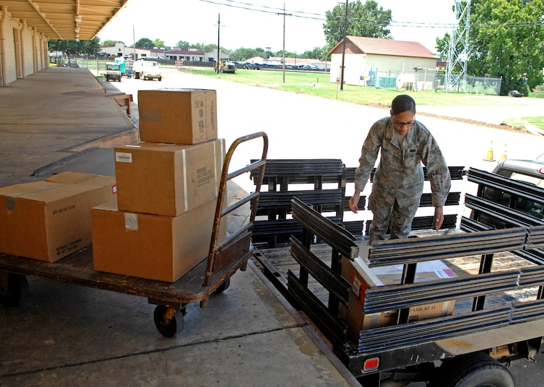 Airman 1st Class Gabrielle Magee, 2nd Logistics Readiness Squadron Aircraft Parts Store apprentice, picks up ordered parts at the main 2 LRS warehouse on Barksdale Air Force Base, La., July 18. The 24-hour APS stores more than 700 parts at the flightline warehouse for quick access to fix problems on the B-52H Stratofortress. (U.S. Air Force photo/Staff Sgt. Jason McCasland)(RELEASED)