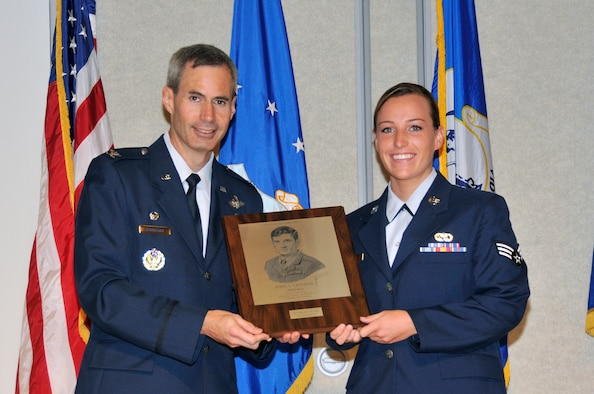 McGHEE TYSON AIR NATIONAL GUARD BASE, Tenn. - Senior Airman Brennan M. Gill, right, receives the John L. Levitow honor award for Airman Leadership School Class 12-6 at the I.G. Brown Training and Education Center from Timothy J. Cathcart, commander, July 19, 2012. The John L. Levitow award is the highest honor awarded a graduate of any Air Force enlisted professional military education course. (National Guard photo by Master Sgt. Kurt Skoglund/Released)
