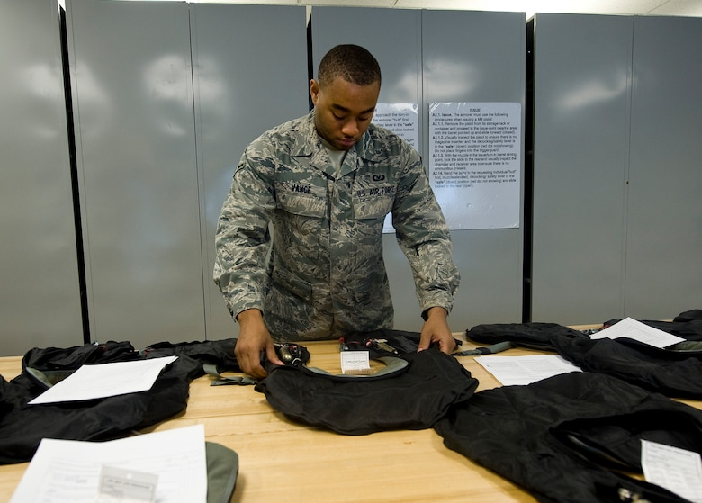 Airman Delonte Vance, 2nd Operations Support Squadron aircrew flight equipment journeyman, inspects a life preserver unit on Barksdale Air Force Base, La., July 19. The LPUs must be inspected yearly along with survival vests and other equipment. Other pieces, such as helmets and oxygen masks, are inspected every 30 days. LPUs inflate with air to help the wearer float if they are forced to eject over water. (U.S. Air Force photo/Staff Sgt. Chad Warren)(RELEASED)