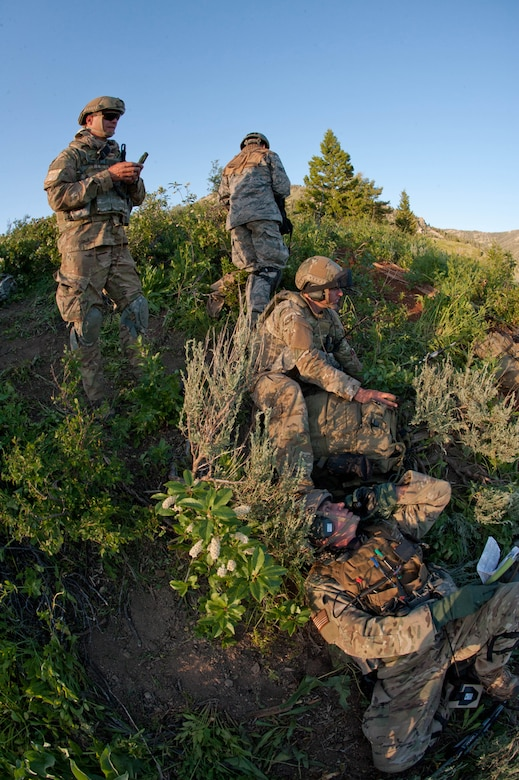 Members of the 124th Air Support Operations Squadron (ASOS) of the Idaho Air National Guard participate in intensive outdoor training during exercise Mountain Fury II throughout the Idaho Sawtooth National Forest, June 25. Members of ASOS perform small unit tactics, mounted patrol with HMWVVs, Close Air Support missions, and over watch with the help of the 190th Fighter Squadron's A-10 Aircraft and B Company, 1-214th General Support Aviation Battalion (GSAB) CH-47 Chinook Helicopters, Idaho Army National Guard Apache Helicopters and 728th Air Control Squadron, Mt. Home, June 19 through June 27.