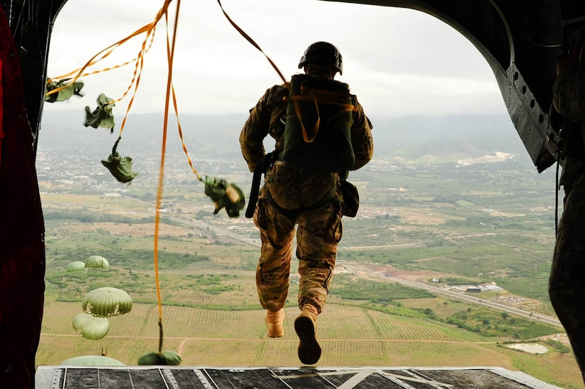 SOTO CANO AB, Honduras – A U.S. Army paratrooper exits a CH-47 Chinook helicopter during a combined airborne exercise at Joint Task Force-Bravo. (U.S. Air Force photo by 1st Lt. Christopher Diaz)