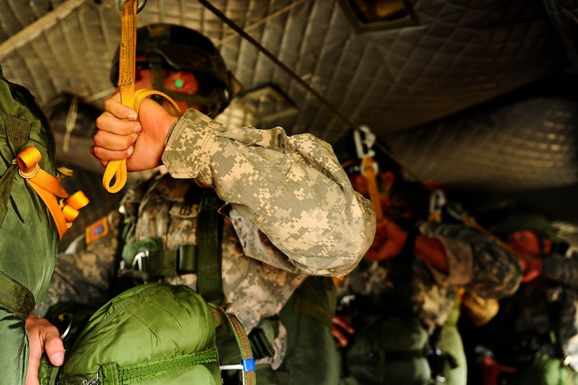 SOTO CANO AB, Honduras – U.S. Army paratroopers hold the static line in a CH-47 Chinook helicopter during a combined airborne exercise at Joint Task Force-Bravo. (U.S. Air Force photo by 1st Lt. Christopher Diaz)