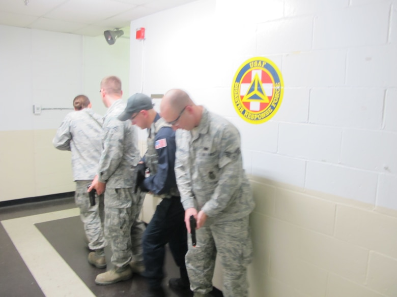 The 102nd Intelligence Wing of the Massachusetts Air National Guard hosted the Federal Protective Service at Otis Air National Guard Base to conduct 'active shooter' training for both law and non-law enforcement members of the Massachusetts Military Reservation, June 13-14, 2012. The second training day concluded with Airmen from the 102nd Security Forces Squadron using tactics taught during the classroom lecture. In practical application, the Airmen were given scenarios which they had to rapidly respond to. (Air National Guard photo by 1st Lt. Jean Riordan/Released)