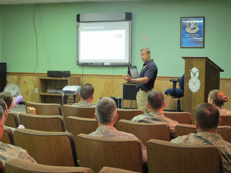 The 102nd Intelligence Wing of the Massachusetts Air National Guard hosted the Federal Protective Service at Otis Air National Guard Base to conduct 'active shooter' training for both law and non-law enforcement members of the Massachusetts Military Reservation, June 13-14, 2012. The first training day consisted of lecture-based, classroom training for Unit Antiterrorism Representatives, preparing them to provide similar training in their respective work centers.  Senior Special Agents provided a look at the history of active shooters and the evolution of Law Enforcement's response. (Air National Guard photo by Staff Sgt. Greg Gresham/Released)