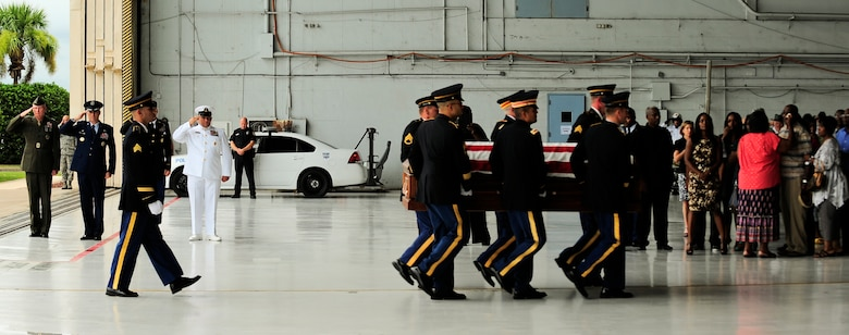 Army Spc. Clarence Williams III is carried by an Army Honor Guard to a hearse July 17, 2012, while his family weeps for him at MacDill Air Force Base, Fla. Williams died July 8, of wounds suffered by an improvised explosive device when enemy forces attacked his unit in Maidan Shahr, Wardak province, Afghanistan. (U.S. Air Force photo by Staff Sgt. Angela Ruiz)