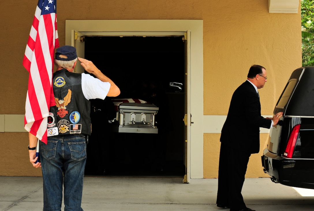 A veteran salutes fallen hero Army Staff Sgt. Ricardo Seija as he is taken into a funeral home July 17, 2012, in Tampa Fla. Seija died July 8, 2012. The 31-year-old Soldier is survived by his widow and a young son. (U.S. Air Force photo by Staff Sgt. Angela Ruiz)