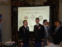 BUCHAREST, Romania — Col. Winfield Keller (left), Global Deployments project manager, and Col. D. Peter Helmlinger, U.S. Army Corps of Engineers Europe District commander, attended the Romania Industry Day here, June 13, 2012.