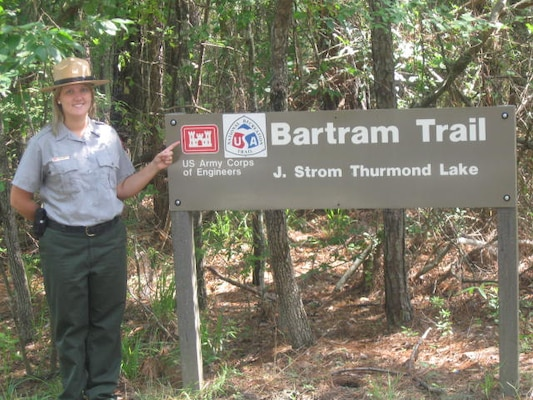 CLARK HILLS, S.C. — Krista McCuen, U.S. Army Corps of Engineers Savannah District Park Ranger, stands next to a trail marker at the Bartram Trail, which was designated as a National Recreation Trail by the Department of the Interior.