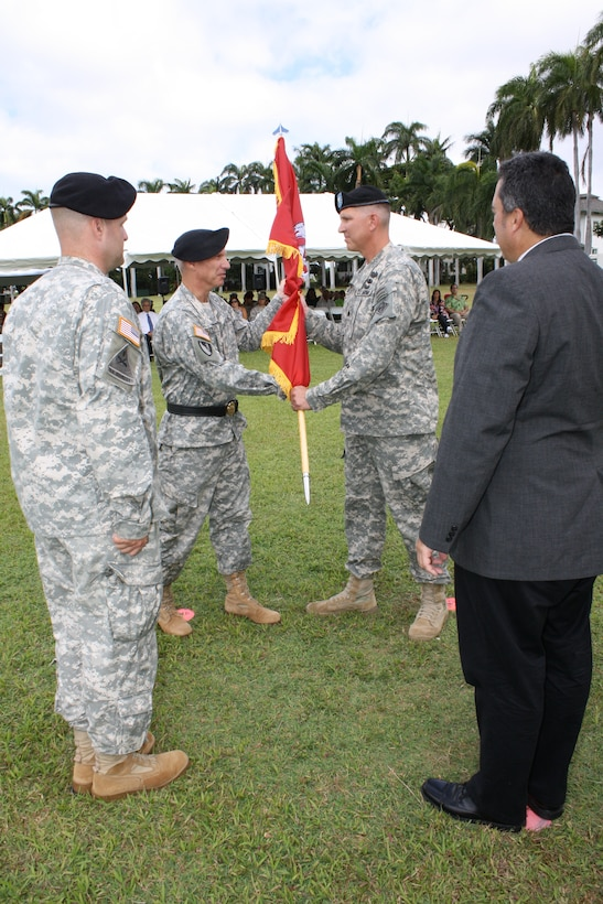FORT SHAFTER, HI — Lt. Col. Thomas D. Asbery (back right) receives the unit colors from Pacific Ocean Division Commander Brig. Gen. Richard L. Stevens becoming the 68th Commander of the U.S. Army Corps of Engineers Honolulu District July 18, 2012. Looking on are outgoing District Commander Lt. Col. Douglas B. Guttormsen (front left), and Anthony J. Paresa, Deputy District Engineer and Chief, Programs and Project Management Division. Stevens hosted the ceremony at Historic Palm Circle Parade Field at Fort Shafter, Hawaii. For his outstanding work and contributions to the Honolulu District, Guttormsen received the Meritorious Service Medal. Guttormsen leaves to become the Division Engineer for the 25th Infantry Division, Schofield Barracks, Hawaii. Asbery most recently served as the Executive Officer to the Commanding General, Human Resources Command, Fort Knox, Kentucky. Asbery deployed twice in support of Operation Iraqi Freedom. He also deployed to the Mississippi Coast in support of Hurricane Katrina disaster relief efforts in 2005 as a Forward Engineer Support Team leader.