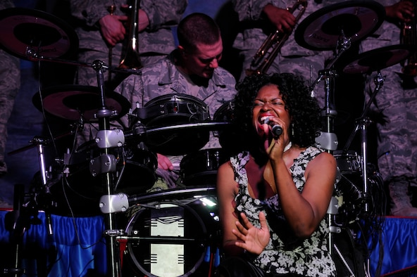 SOUTHWEST ASIA – Tech. Sgt. Tonie Marshall, Tops In Blue vocalist, sings during their performance at the Rock Theater here July 17.  The performance featured renditions of The Doobie Brothers, Earth, Wind and Fire, Michael Jackson and Maroon 5. (U.S. Air Force photo/Staff Sgt. Alexandra M. Boutte)