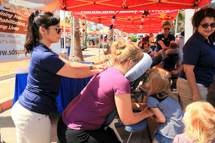 Families attending the 13th annual Community Day Celebration were given the opportunity to experience massages given by the San Diego Spine and Rehabilitation at the San Onofre Community Center, July 21. Other sponsors at the event include: Classic Chariots, Pendleton Family Dental, HG Innovative Market Solution and USAA.