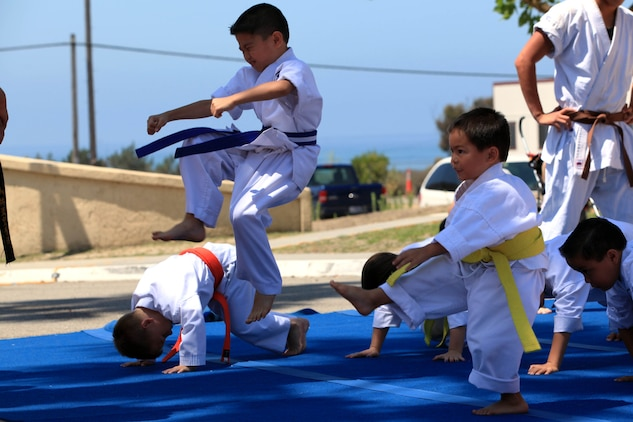 Students of Shorin Ryu Karate demonstrate techniques and physical fitness to the audience at the 13th annual San Onofre Community Center Community Day Celebration, July 21. Along with the karate demonstration, other performers presented skits and demonstrations for service members and their families.