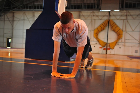 Senior Airman Christian Manning, Air University A4/6 Logistics and Programming computer programmer completes a set of diamond pushups at the Maxwell Gym Annex Wednesday. (U.S. Air Force photo by Senior Airman Christopher Stoltz)