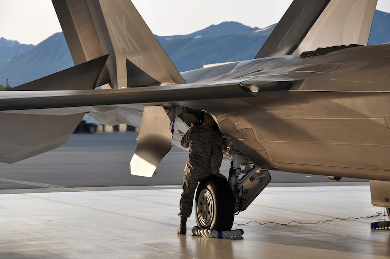 Staff Sgt. Justin Klein, an F-22 crew chief and Reservist assigned to the 477th AMXS, inspects the aircrafts hydraulic system during the aircraft launch for the 3rd Wings Turkey Shoot July 19. Aircraft Maintainers were evaluated on their ability to produce combat ready aircraft. (U.S. Air Force Photo/Tech. Sgt. Dana Rosso)