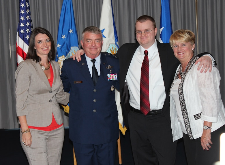 Lt. Gen. (Dr.) Thomas W. Travis, Air Force Surgeon General, stands with his family during his promotion ceremony on July 20 at the Bolling Club. (Photo by Jon Stock, U.S. Air Force)
