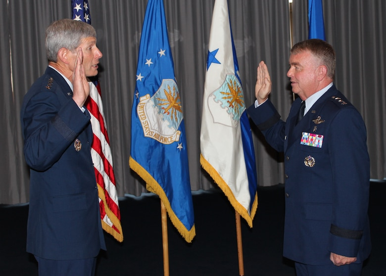 Air Force Chief of Staff Gen. Norton A. Schwartz officiates the promotion of Lt. Gen. (Dr.) Thomas W. Travis, Air Force Surgeon General, during a ceremony on July 20 at the Bolling Club. (Photo by Jon Stock, U.S. Air Force)