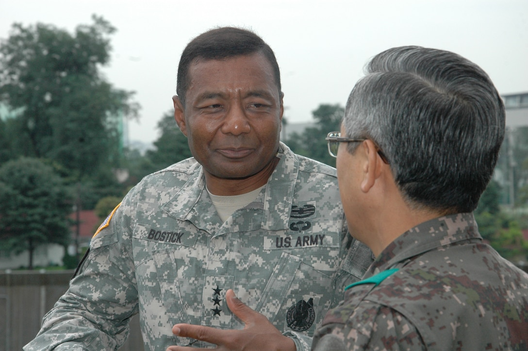 SEOUL, Republic of Korea — Lt. Gen. Thomas Bostick, U.S. Army Corps of Engineers Commanding General, listens to Maj. Gen. Park Kye-su, director of the Republic of Korea Defense Installations Agency, as the two discuss various joint U.S. and Korean construction projects on the peninsula July 17. Bostick met with U.S. and Korean military officials and toured the multi-billion dollar construction project at U.S. Army Garrison Humphreys, about 40 miles south of Seoul. The Corps of Engineers has about 37,600 military and civilian personnel providing project management and construction support in more than 100 countries.