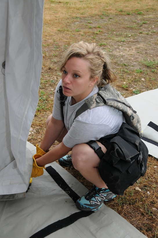 Senior Airman Ashley Frederick, 148th Fighter Wing, Minnesota Air National Guard helps put up a tent July 19, 2012 in support of PATRIOT 2012.  PATRIOT 2012 is an annual National Guard emergency reponse exercise and is comprised of more than 1,100 military and civilian personnel.  (National Guard photo by Master Sgt. Ralph J. Kapustka/Released)