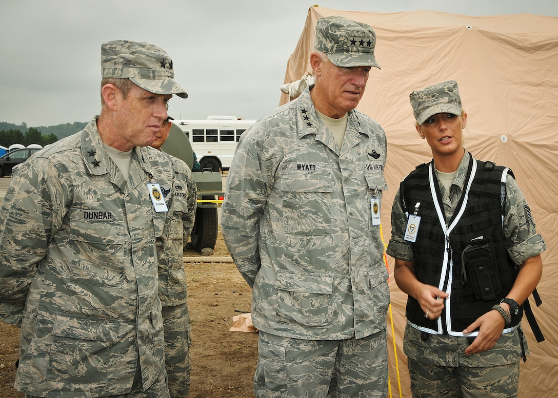 Maj. Gen. Don Dunbar, Adjutant General of Wisconsin and Lt. Gen. Harry M. Wyatt III, Director of the Air National Guard talk with Staff Sgt. Emeri Rohweder while touring different aspects of PATRIOT 2012 at Volk Field, Wis. July 19, 2012.  PATRIOT 2012 is an annual National Guard emergency response training exercise comprised of more than 1,100 military and civilian personnel.  (National Guard photo by Master Sgt. Ralph J. Kapustka)