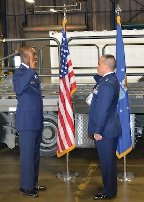 WRIGHT-PATTERSON AIR FORCE BASE, Ohio – Lt. Col John Marang, 87th Aerial Port Squadron commander, administers the oath of office to Tech. Sgt., now 1st Lt. Will Smith, 87th APS air transportation craftsman, during Smith's commissioning ceremony May 19. (U.S. Air Force photo/Master Sgt. Charlie Miller)