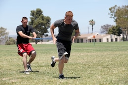 Cpl. Devin Johnson, sensor support for Artillary, Marine Corps Base Camp Pendleton, sprints with resistance during the Combat Conditioning Training Course at the Paige Field House on Marine Corps Base Camp Pendleton, July 24.