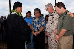 (From left) Kahu (Hawaiian minister) Curt Pa'alua Kekuna, Lloyd Arakaki, principal at Architects Hawaii, Ltd., Col. Brent S. Willson, commander of Headquarters and Service Battalion, U.S. Marine Corps Forces, Pacific, and Dave Ott, AMEC vice president, pray together during a blessing ceremony at the construction site of the new fitness center here July 18. The fitness center is expected to be open by August 2013.
