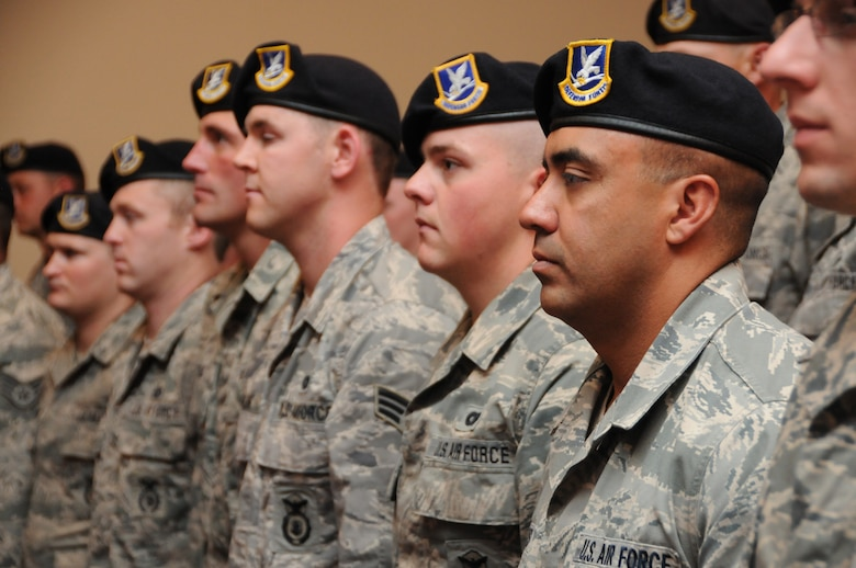 Staff Sgt. William Briones stands at attention with his fellow Airmen of the 173rd Security Forces Squadron during a demobilization ceremony, Saturday, July 21, 2012, recognizing 26 Airmen from the 173 Fighter Wing Security Forces who recently deployed to Afghanistan for six months. (Oregon Air National Guard photo by Tech. Sgt. Jefferson Thompson/released)