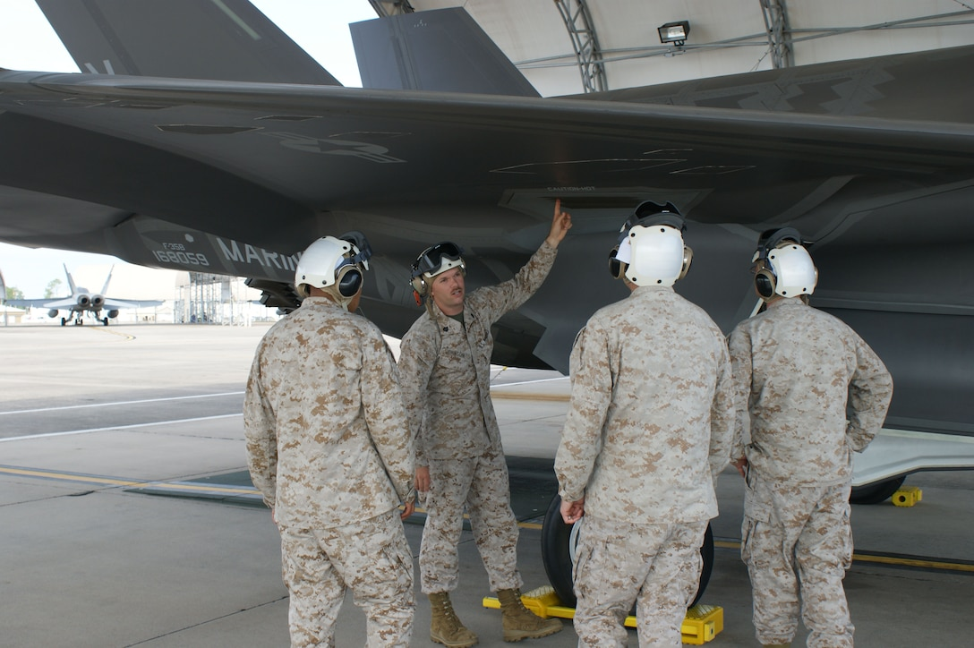 Students learn about the F-35B Lightning II joint strike fighter's wing system from USMC Staff Sgt. Christopher Johnson (2nd from left) during training at Eglin Air Force Base, Fla., Jul. 19, 2012.  The USMC is standing up their first-ever field training detachment with the 372nd Training Squadron Detachment 19 at Eglin, part of the 982nd Training Group at Sheppard Air Force Base, Texas. (U.S. Air Force photo/Dan Hawkins)