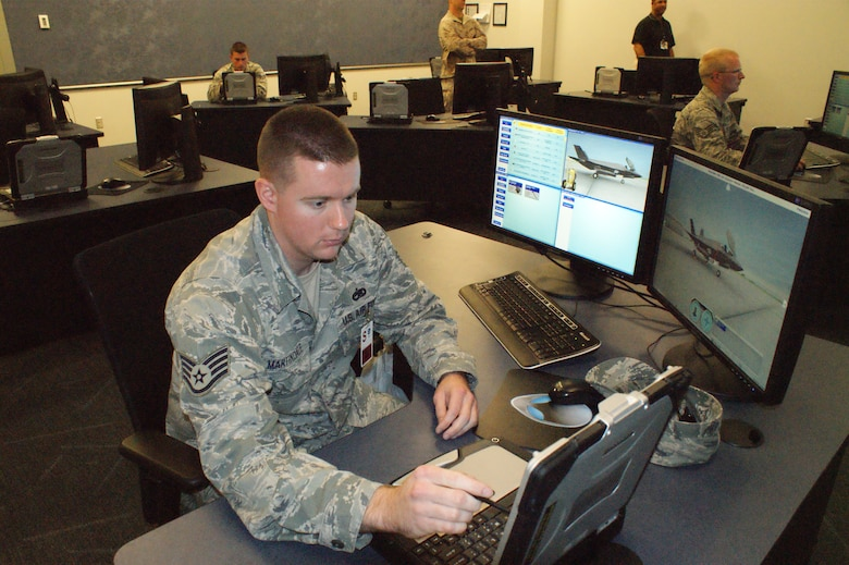 Staff Sgt. David Martindale, 31st Test and Evaluations Squadron at Edwards Air Force Base, Calif. and an F-35 maintenance student, gets ready to work on a training problem Jul. 19, 2012 at Eglin Air Force Base, Fla.  F-35 maintenance training is conducted by the 372nd Training Squadron Detachment 19, part of the 982nd Training Group at Sheppard Air Force Base.  (U.S. Air Force photo/Dan Hawkins)