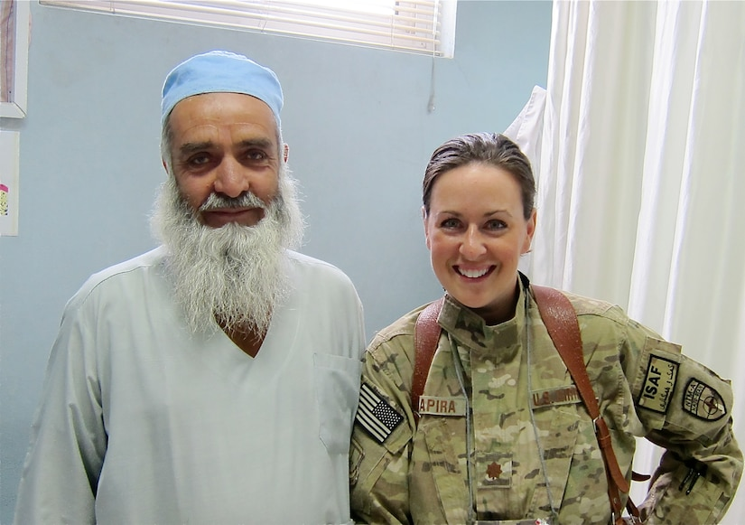 Major Courtney Schapira, 628th Medical Group dentist, poses for a photograph with Sayad Dost-M Amiri, Paktia Regional Military Hospital dental clinic chief, in Gardez, Afghanistan sometime during her deployment from November 2011 until May 2012. Schapira was the first, and only, Air Force dental advisor in Afghanistan. (Courtesy photo)