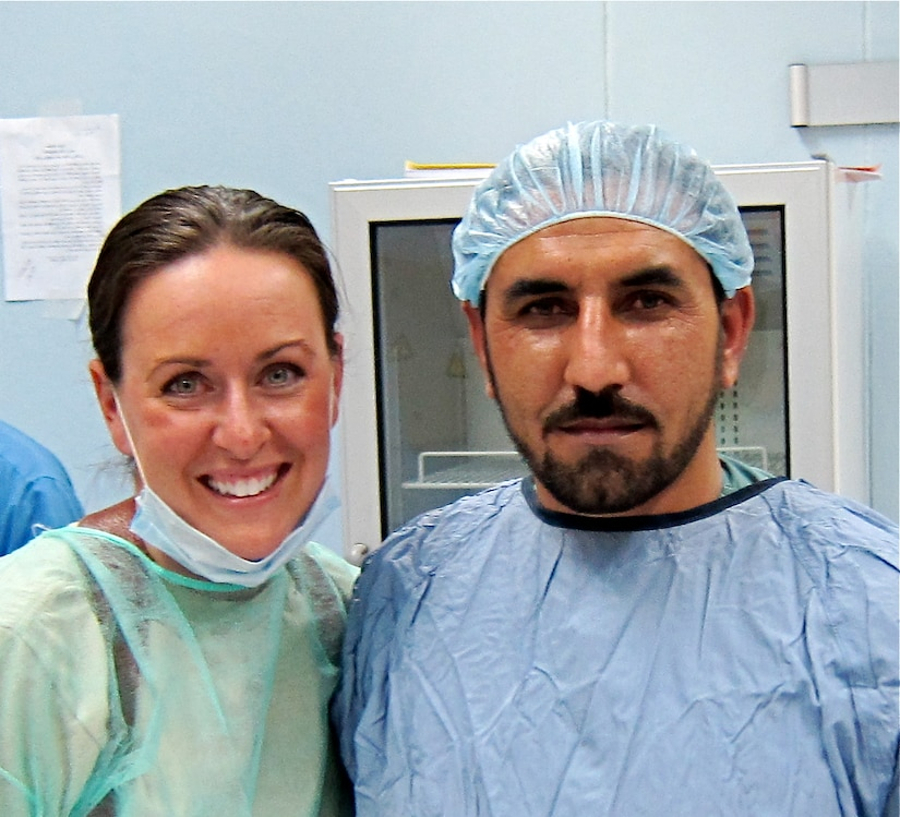 Major Courtney Schapira, 628th Medical Group dentist, poses for a photograph with Janat Khan Hamdard post-surgery at the Paktia Regional Military Hospital in Gardez, Afghanistan sometime during her deployment from November 2011 until May 2012. Schapira was the first, and only, Air Force dental advisor in Afghanistan. (Courtesy photo)