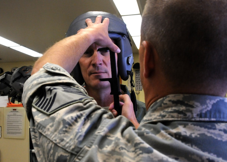 Maj. Gen. Timothy Zadalis, Director of Intelligence Operations and Nuclear Integration Headquarters at Air Education and Training Command, begins preparations for his familiarization flight in an F-15 Eagle with the help of Master Sgt. Kenneth Shearer, 114th Fighter Squadron, at Kingsley Field, Ore., July 24, 2012. Kingsley Field was just moved under the command of Zadalis earlier this year. (Air National Guard photo by Airman 1st Class Penny Hamilton/Released)