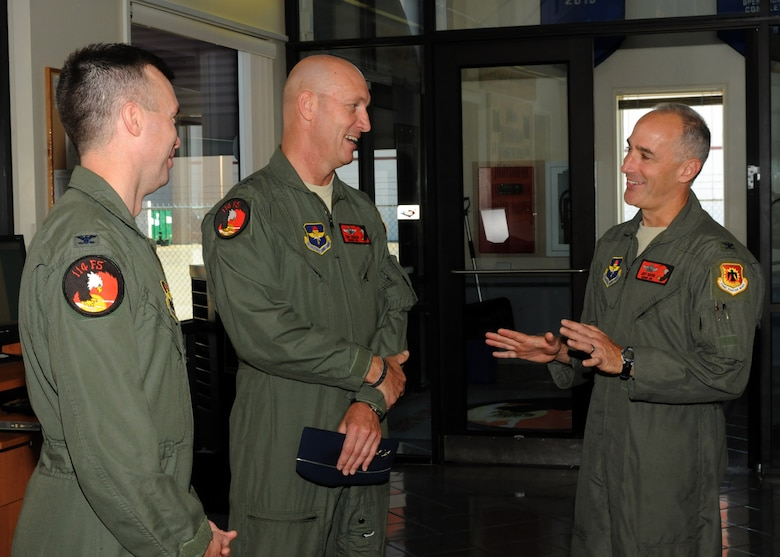 Maj. Gen. Timothy Zadalis, Director of Intelligence Operations and Nuclear Integration Headquarters at Air Education and Training Command, visits members of the 173rd Fighter Wing and 114th Fighter Squadron before beginning preparations for his incentive flight in an F-15 Eagle at Kingsley Field, Ore., July 24, 2012. Kingsley Field was just moved under the command of Zadalis earlier this year. (Air National Guard photo by Airman 1st Class Penny Hamilton/Released)