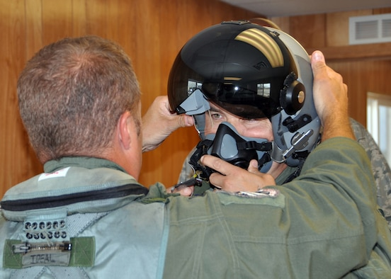 JOINT BASE PEARL HARBOR-HICKAM, Hawaii - U.S. Air Force Lt. Col. Tom McNurlin from the Air National Guard and Air Force Reserve Test Center in Tucson, Ariz., helps U.S. Air Force Col. John Breazeale, 917th Fighter Group commander, adjust his helmet with the Scorpion helmet-mounted system prior to a flight during Rim of the Pacific exercise July 17,2012.  The Scorpion system, along with the Lightweight Airborne Recovery System, known as LARS, was for the first time maritime operationally tested during the exercise. The world's largest international maritime exercise, RIMPAC provides a unique training opportunity that helps participants foster and sustain the cooperative relationships that are critical to ensuring the safety of sea lanes and security on the world's oceans. (U.S. Air Force photo by Master Sgt. Mary Hinson)