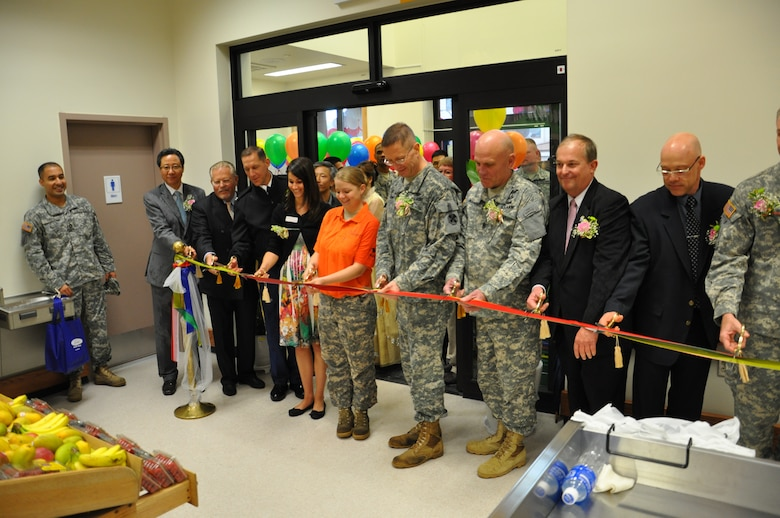 Members of the Defense Commissary Agency, Installation Management Command, the Eighth U.S. Army, and the Far East District cut the ribbon for a new commissary at K-16 Airfield May 17.