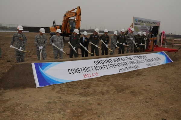 The distinguished guests broke ground on the new Operations and Aircraft Maintenance Unit Facility April 10 at Osan Air Base.