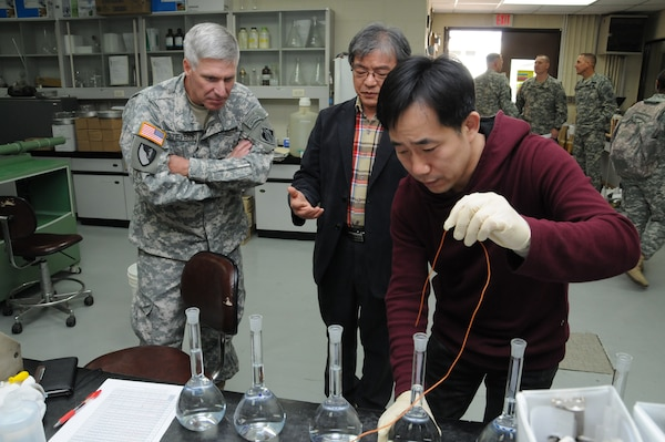 Brig. Gen. Richard Stevens, U.S. Army Corps of Engineers, Pacific Ocean Division Commander, watches soil testing at Far East District.