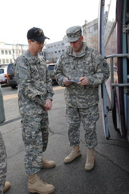 Kevin Shanahan, FED Business Process Manager, checks in with Sgt. Maj. David Breitbach, Security Plans and Operations, before departing to Daegu in support of Key Resolve 2012. (Photo by Patrick Bray)