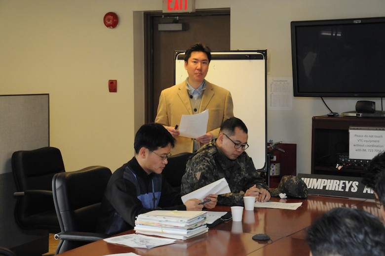 Ha Chae-un, Engineer for FED Humphreys Area Office, gave engineers from the Korean Ministry of National Defense an overview of U.S. Army Garrison Humphreys expansion and the workings of the area office during the MND Exchange Program Feb. 15.  (Photo by Patrick Bray)
