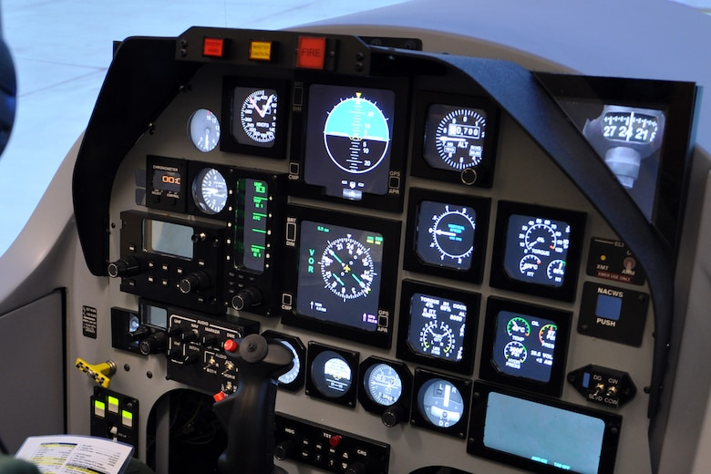 The new T-6 Texan II simulator instrument panel uses a single flat panel monitor and software to recreate the look and feel with digital displays and gauges. (U.S. Air Force photo/Staff Sgt. Clinton Atkins)