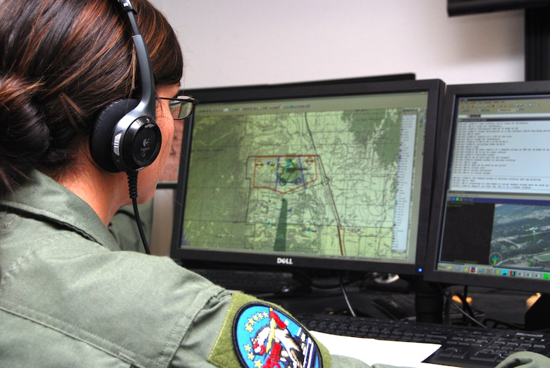 Cadet 3rd Class Kasilie Shepherd coordinates an unmanned aerial system mission in the 557th Flying Training Squadron facility at the Air Force Academy Airfield July 20, 2012. Instructor pilot cadets and permanent-party faculty create scenarios that allow students to work with classmates enrolled in the Expeditionary Survival and Evasion Training summer program, simulating operational Air Force missions. Shepherd is assigned to Cadet Squadron 35. (U.S. Air Force photo/Don Branum)