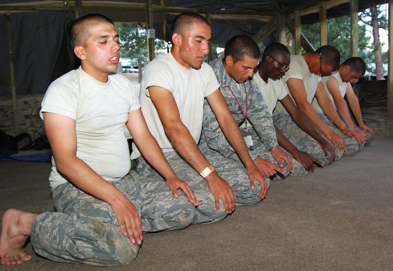 Basic cadets kneel during maghrib, or sunset prayers, in Jacks Valley's Muslim chapel July 22, 2012. Islam typically requires five daily prayers, to be done before sunrise, at noon, in the mid-afternoon, just after sunset and before going to bed for the evening. (U.S. Air Force photo/Don Branum)