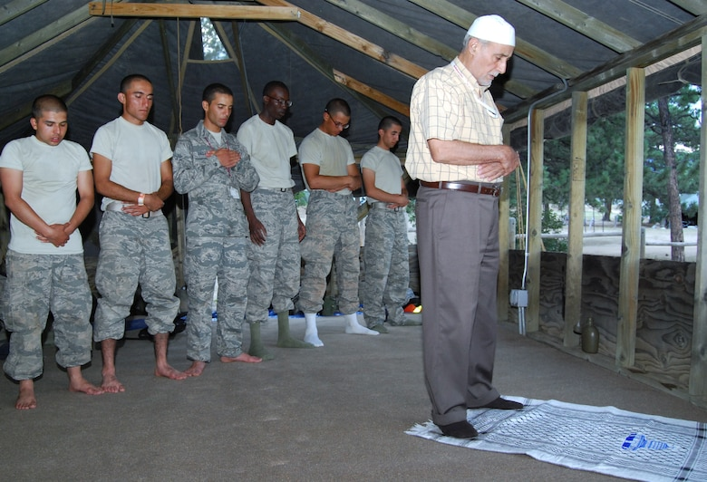 Imam Mohamed Jodeh leads basic cadets in evening prayer during a Muslim service in Jacks Valley July 22, 2012. While Muslims normally fast during Ramadan, which began July 20, Jodeh instructed the basics not to fast while they underwent Basic Cadet Training. (U.S. Air Force photo/Don Branum)