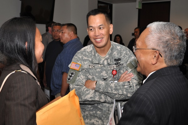 Col. Mark Toy, District commander speaks with two of the more than 200 business owners that met division chiefs and project managers from the U.S. Army Corps of Engineers Los Angeles District to learn about contract opportunities and, in some cases, simply to learn how to get started in doing business with the Corps during an open house July 25.