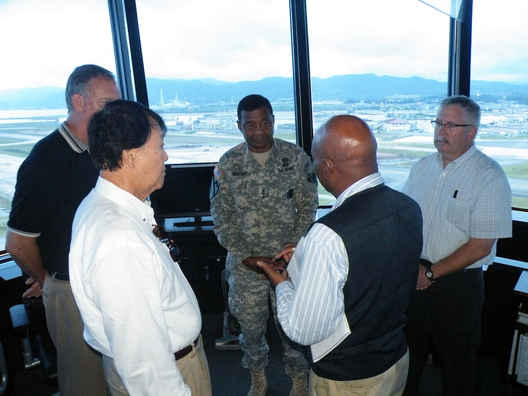 JAPAN — Lt. Gen. Thomas P. Bostick, U.S. Army Corps of Engineers commanding general, receives a briefing in the air traffic control tower during his visit to Marine Corps Air Station, Iwakuni, Japan July 19. Bostick was in Japan July 18-21, 2012 meeting with USACE Japan District members and learning firsthand about our great team on the leading edge of the engineering world in the Pacific.