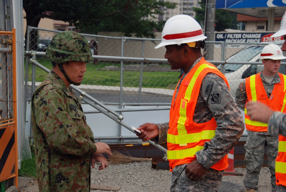 CAMP ZAMA, Japan — Lt. Gen. Thomas P. Bostick, commanding general of the U.S. Army Corps of Engineers, exchanges command coins with Col. Takeshi Ishimaru, commander, 4th Engineer Group, Japan Ground Self Defense Force, following a briefing here, July 20, 2012.
