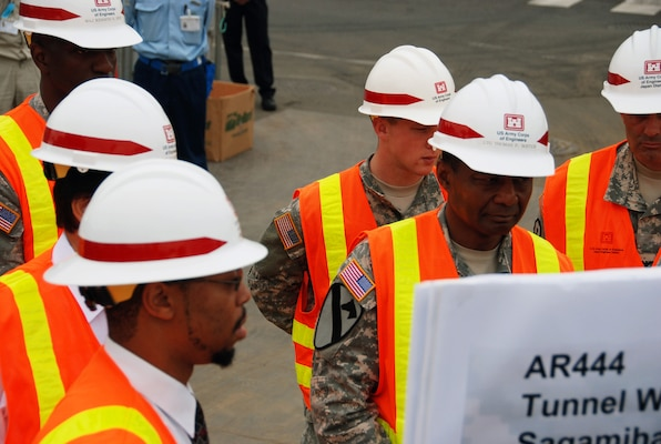 JAPAN — Lt. Gen. Thomas P. Bostick, commanding general of the U.S. Army Corps of Engineers (right), receives a briefing from Cedric Bazemore, the Kanagawa resident engineer, during his visit to the USACE Japan Engineer District July 20, 2012.
