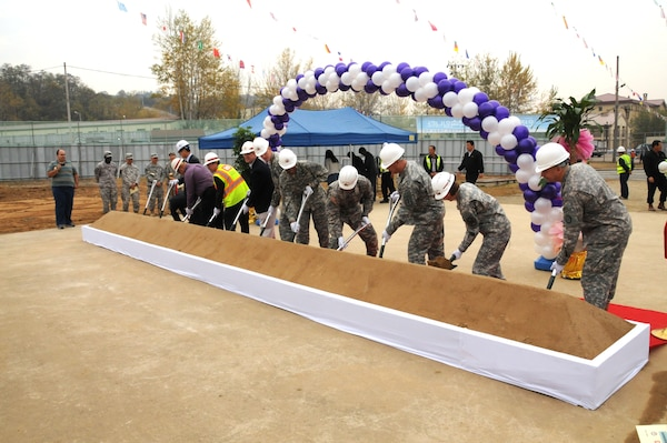 Members of the U.S. Army Corps of Engineers, Far East District, along with representatives from the 65th Medical Brigade and U.S. Army Garrison Daegu break ground on the new combined health and dental clinic for Camp Carroll Nov. 3. This facility will include a troop medical clinic, preventive medicine facilities, and after hours walk-in care facilities and replace the out-dated, existing troop medical clinic and dental clinic. (Photo by Patrick Bray)