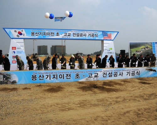 Gen. James Thurman (ninth from left), United States Forces Korea Commander, Kim, Kwan-jin (tenth from left), Korean Minister of National Defense, and other distinguished guests break ground on a new elementary and high school at U.S. Army Garrison Humphreys Sept. 2.  The U.S. Army Corps of Engineers, Far East District will construct the projects which will be the first vertical construction projects as part of the Yongsan Relocation Program and are expected to be complete by summer 2013.  (Photo by Patrick Bray)